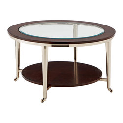 "Steve Silver - Norton Cocktail Table - Glass Top - 35"" Round - The vivacious Norton Castered Glass-Top Coffee table will add excitement and energy to any room. The espresso wood frame top with inset beveled glass is attached to brush nickel castered legs making a stunning impression on your home.;Features: Glass Top/Metal/Wood Base (Espresso Finish);Contemporary Style;Sturdy gauge metal;8mm Tempered, Beveled Glass;Table Base w/ casters;Weight: 59 lbs.;Dimensions: 35""L x 35""W x 20""H"