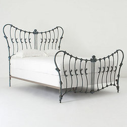 Cosette Bed - Sometimes you need a piece of furniture that is just over the top. The lines and curves of this bed are definitely exaggerated. It reminds me of Alice in Wonderland, and it would be fun and cartoonish for anyone who has a sense of humor when it comes to furniture.