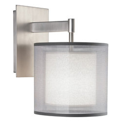 Robert Abbey - Saturnia Wall Sconce - No matter how clean and modern your style is, you can still get a little dreamy with your lighting. This sconce does it with a transparent outer shade of shimmering silver or bronze, which encircles the lamp like Saturn's rings, giving the light a misty halo. One or two of these in the hallway, bathroom or bedroom will instantly soften the atmosphere without actually softening your look.