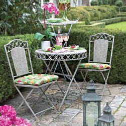"Bordeaux Bistro Table and Chair Set - Table for two. Bring the romance of Paris to your garden, patio or breakfast nook. Folding table and two chairs are easy to move and store. Metal. Table is 28.5""h x 45"" dia. Chair is 37.5""h x 15""w x 16""d. Cushion sold separately. 3""h x 15""w x 16""d. 100% polyester."