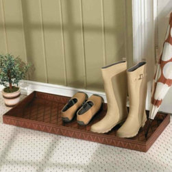 Entryway Boot Tray - Nothing's more annoying than having a clean house and seeing people come in wearing boots filled with dirty snow. I keep these boot trays right by the door so the kids are sure to put their shoes in the right place.