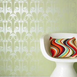 """Graham & Brown Hula Wallpaper - 'Hula' is one of designer Barbara Hulanicki's most celebrated wallpaper designs and for good reason as it mixes a beautiful pattern with a relaxing colour scheme to great effect. Using a subtle and understated pale sage green colour it offers a modern take on a classic flowing motif. The design is also available in a more striking black and white colour to give your walls more of an impact. About Graham & Brown Founded in 1946 by friends Harold Graham and Henry Brown Graham & Brown has always been about brightening the home. From modest beginnings with surplus metallic paper and an embossing machine Graham & Brown has grown to include a range of products such as Superfresco - easy to hang and able to be painted or washed - and other """"""""paste the wall"""""""" products that allow homeowners greater ease in hanging wallpaper themselves. The company's product line today includes wall art paint and children's decor in addition to its famous wallpaper."""