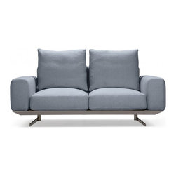 Prichard Two-seat sofa - Slate Blue fabric - Contemporary in design, yet surprisingly versatile, Prichard allows you to reimagine what your living space can be.The Pritchard is handcrafted with premium linen blend upholstery, high-resilience foam & goose down cushions, and fitted with a base of high-density steel forged right at our factory.The Pritchard two-seater adds style with substance to small spaces.  We suggest mixing and matching the Pritchard's contemporary design with unexpected accessories - vintage rugs, an heirloom coffee table, or wild plants. The sofa's neutral tones are specifically designed to support colorful pillows and throws.  The Slate Blue is a stylish blue grey color.Factory Description:On an early ID scouting trip, we came across a factory whose craftsmanship and attention to detail immediately caught our attention. The products coming off their lines were exceptional. Everyone we spoke to articulated a passion for quality design, and the factory's product engineers were meticulous about every aspect of the manufacturing process: clean lines, premium inputs, and unique features we'd never seen before. We knew right away we wanted to work with them. Dimensions: 69*41*35