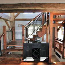 Traditional Staircase by Green Mountain Timber Frames