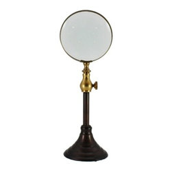 Small Magnifying Glass On Stand - Antique brass magnifying glass.