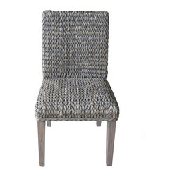 Four Hands - Molokai Dining Chair - The Grass Roots Collection combines fitted lines with elegant texture, perfect for bringing the outdoors in. This comfortable line is made from all natural banana leaf, abaca, mahogany, and mango wood.