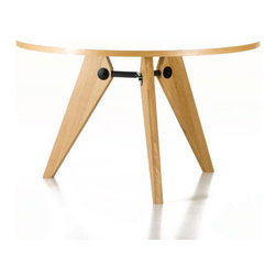 Guéridon Table by Jean Prouvé for Vitra - Prouvé designed the Guéridon Table, with its particularly impressive structural clarity, for the University of Paris. This wooden table proves that modern tables do not have to be made of steel and glass and offers a variation on Prouvé's standard formal language, with its architectural overtones, by using a natural material.