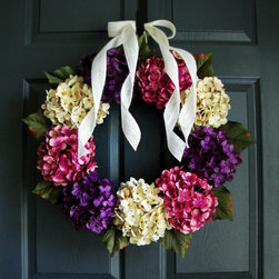 Make An Elegant Entrance by HomeHearthGarden - A touch of elegance. Beautiful artificial hydrangea colors outline this wreath for front door or weddings. A handmade wreath creation with premium, full-bodied, artificial hydrangea flowers accompanied with a duo white burlap bow on a grapevine wreath base.