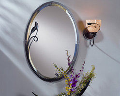 "Hubbardton Forge - Leaf Beveled Mirror - In the bath, over a hall table or in the bedroom, our mirrors are simple and understated and serve as the perfect complement to our entire lighting family. Dress up your bathrooms with traditional hand-forged towel holders, with your choice of curved and straight designs in our signature natural iron finish. Features: -Mirror. -Available in mahogany, bronze, dark smoke, brushed steel, black or natural iron finish. -Oval shape. -Can be mounted vertically or horizontally. -Made in USA. -Overall dimensions: 31.7"" H x 22.3"" W."