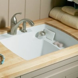 "Sterling - Sterling 995-U-47 Almond Latitude Latitude Vikrell Undermount Utility - Latitude Vikrell Undermount Utility Sink, 25"" x 22"" x 12""Made of solid Vikrell material, the durable, easy to install Latitude utility sink offers subtle, contemporary style. The unique quarter-deck design provides shelf space for storage and cleaning, and adds to the overall modern appeal.Features:Unique design features a quarter-deck; perfect for cleaning smaller items such as paint brushesSlight outside curves add a style dimension not found in other utility sinksMade of solid Vikrell material with color molded throughoutBond surface texture maintains a superior stain and scratch resistanceDrill marks provided for drilling the faucet holesConforms to CSA B45 National Consensus Standards"