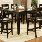 Steve Silver Co. - Victoria 5-Pc Counter Height Dining Set - Includes table and four counter chairs. Bench not included. Contemporary style. One 18 in. butterfly leaf. Corner block construction. Tongue and groove joints. Rectangular shape table. Durable chocolate vinyl chair seat upholstery. Made from solid wood. Mango finish. Made in Vietnam. Seat height: 24 in.. Counter chair: 21 in. W x 18 in. D x 44 in. H (26.5 lbs.). Table minimum: 54 in. L x 36 in. W x 36 in. H (137.5 lbs.). Table maximum: 54 in. L x 54 in. W x 36 in. H