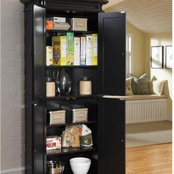 Home Styles - Home Styles Americana Black Pantry - 5004-694 - Shop for Pantries from Hayneedle.com! Perfect for cereal canned goods and all your favorite kitchen ingredients or as an elegant linen closet for your home's hallway the Home Styles Americana Black Pantry is a versatile cabinet with more than enough space to meet all your storage needs. Crafted from hardwood solids and engineered wood this piece is incredibly sturdy but also incredibly stylish thanks to its traditional pastoral design and recessed door panels. Two storage cabinets open to fixed and adjustable shelving that can be customized to fit your needs. Measures 30W x 16D x 72H inches; some assembly required.About Home StylesHome Styles is a manufacturer and distributor of RTA (ready to assemble) furniture perfectly suited to today's lifestyles. Blending attractive design with modern functionality their furniture collections span many styles from timeless traditional to cutting-edge contemporary. The great difference between Home Styles and many other RTA furniture manufacturers is that Home Styles pieces feature hardwood construction and quality hardware that stand up to years of use. When shopping for convenient durable items for the home look to Home Styles. You'll appreciate the value.
