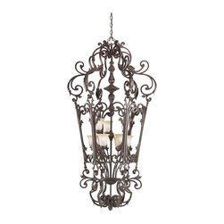 KICHLER - KICHLER 2472CZ Rochelle European Traditional Foyer Light - A luxurious line of lighting that possesses a classic aesthetic with just a bit more ornamentation, you cannot do much better than this gorgeous 9-light Foyer fixture. The fixture's prominent romantic details include forged leaf accents and junction body covers with the shell-like curves of classic rococo, but softened to fit more comfortably into today's room settings. Adding to the look is a Creme Carmel glass which casts a soft, golden glow to bring elegant warmth to your lighting. The hand blown extra heavy glass is finished to resemble the color and texture of Creme Brule, and is a delightful complement to the richness of the Carre Bronze finish. It uses 60-watt (max.) bulbs.