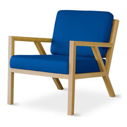 Gus* - Truss Chair - Truss Chair  by Gus Modern    At A Glance:   Truss fits right into any contemporary or mid-century setting. Reminiscent of the iconic lounge chair designs of the 1950's, this stylish Gus Modern chair features a combination of upholstered soft foam cushions and a highly visible solid oak frame.   What's To Like:  This is a seriously comfortable accent chair that is suitable for small spaces, with a modest footprint and comfy cushions.Inspired by the work of the Sarasota School of Architecture, the Truss Chair doesn't let you get away with ignoring it. You'll love looking at it every time you walk into your living room.The Truss Chair's craftsmanship is top-notch - it'll last.  What's Not to Like:   The only thing we can think of is that it costs a pretty penny. But it's a sweet-looking chair with Grade A materials, so that seems to balance.  The Bottom Line:   With architectural style and smoothly moder