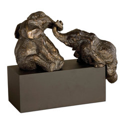 None - Playful Pachyderms Bronze Figurines - Convey strength, royalty and grace with the Playful Pachyderms figurine in bronze patina. This piece not only conjures beauty but also a whimsical awareness.