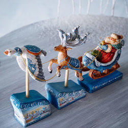 G. DEBREKHT - G. DEBREKHT Santa on Sleigh with Deer and Goose - What sets G. Debrekht creations apart from the norm is the unexpected, highly detailed scene found on each one. Putting a creative twist to a traditional holiday scene, this lovable, hand-painted figurine depicts a goose helping out the reindeer with pu...
