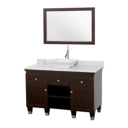 Wyndham Collection - Eco-Friendly Modern Bathroom Vanity - Includes natural stone counter, backsplash, one vessel sink and matching mirror. Faucets not included. Engineered to prevent warping and last a lifetime. Highly water-resistant low V.O.C. finish. 12 stage wood preparation, sanding, painting and finishing process. Floor standing vanity. Deep doweled drawers. Fully extending bottom mount drawer slides. Soft close concealed door hinges. Single hole faucet mount. Plenty of storage space. Brushed steel leg accents. Metal hardware with brushed chrome finish. Two doors and two drawers. White Carrera marble top. White porcelain sink. Made from zero emissions solid oak hardwood. Espresso finish. Vanity: 48 in. W x 22.5 in. D x 36 in. H. Mirror: 24.25 in. W x 36.25 in. HCutting edge, unique transitional styling. A bridge between traditional and modern design, and part of the Wyndham Collection Designer Series by Christopher Grubb, the Premiere Single Vanity is at home in almost every bathroom decor, resulting in a timeless piece of bathroom furniture.