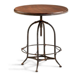 Lucca Table - As in the trattorias of Italy, friends and family will gather round the Lucca Table for conviviality, conversation, and the savoring of fine food. Handsomely designed of raw iron and natural wood, the circular table is perfectly scaled for placement in an eclectic great room, a breakfast nook, or a personal library as a display piece for antique tomes. The table is a complement to the Lucca Chair.