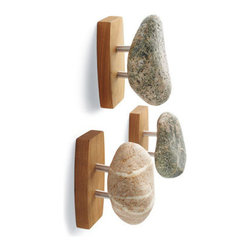 Grandin Road - Stone Hook - With sustainably harvested natural stones at the heart of their design, each of our handcrafted Stone Hooks is a one-of-a-kind work of art. Naturally water-smoothed stones are carefully selected from private rivers and beaches in New England, then responsibly replenished with rough stones. Hooks arrive ready to hang horizontally or vertically and include hanging hardware. Lifetime manufacturer's guarantee. Handmade in New Hampshire. Give your bath an instant spa-quality makeover with natural Stone Hooks, artisan-made in America from sustainably gathered stones and cherry hardwood.  .  .  . Lifetime manufacturer's guarantee .  . Stone sizes and colors vary, naturally . Sold separately. Made in USA.