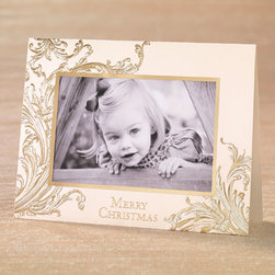 "Exposures - Christmas Memories Photo Christmas Card Set of 18 - Overview Stunning gold-foil baroque scrolls with elegant embossing gracefully encircle your special holiday photo in glistening gold. Our exclusive photo cards are the perfect way to stay in touch and share a special moment with family and friends during the holiday season.  Features:  Pocket cards make it easy to send personal greetings  just print your photo and insert Pre-printed interior verse: ""May your Christmas be filled with warm moments & cherished memories."" Signature ivory card stock with a smooth finish Foil and embossed details Set of 18 photo pocket cards Includes 20 coordinating gold foil-lined ivory envelopes Includes free gold foil envelope seals to add a special finishing touch   Personalization  Card personalization available in a coordinating color and font, imprinted below the pre-printed verse; up to 3 lines, 50 characters per line Envelope personalization available in a coordinating color and font, imprinted on the back flap of the envelope; up to 3 lines, 48 characters per line   Specifications  Folded card size 8"" wide x 6"" high Holds one horizontal 4"" x 6"" photo   Shipping  Please allow an additional 2 weeks for imprinted items No returns on personalized items unless the item is damaged or defective"