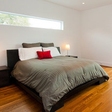 Modern Bedroom by Intexure Architects