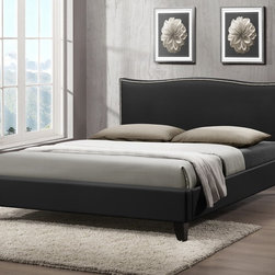 Baxton Studio - Baxton Studio Battersby Black Modern Bed with Upholstered Headboard - Full Size - Turning in for the night is a delight with the Battersby Designer Bed. The simple, minimalist contemporary bed design is made in Malaysia soft, buttery matte black faux leather, foam padding, and an engineered wood frame. Dark brown rubber wood legs plus silver upholstery tack detailing on the perimeter of the headboard add charm. As a full sized platform bed, the Battersby does not require a box spring: only a mattress is needed, which can't atop the wooden slats (included). Maintenance is simple: just wipe the bed�۪s surfaces with a damp cloth before wiping dry. The Battersby Bed is also available in white as well as both black and white in queen size (each sold separately). Assembly is required.  57.09 inches wide x 83.67 inches deep x 37 inches high