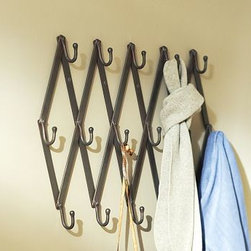 "Accordion Row of Hooks, Bronze finish - Hang coats, towels, scarves and more from this cleverly designed row of hooks, modeled after traditional vintage accordion-style wall racks. Fully Extended: 32.5"" long x 2.5"" deep x 5.5"" high Made of flat iron stock with cast-iron hooks. Finished in antique bronze. Catalog / Internet only."