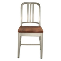 Navy Chair with Wood Seat - Designed in the 1940s, the aluminum Emeco Navy dining chairs have made a resurgence in the design world. These casual chairs can be mixed and matched with a variety of other materials, textures and styles. I like this version of the chair with natural wood seating.