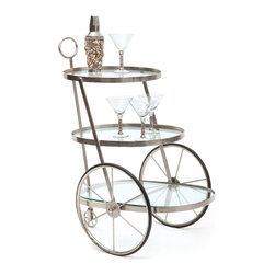 Dapper Bar Cart - Oversized wheels are only the first striking element of this tripod bar cart. The tripod stand is also tipped with a smaller wheel in the same metal as the edges. Three glass shelves fit all your bottles and glasses in style.
