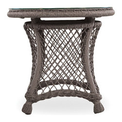 Lloyd Flanders - Lloyd Flanders Vineyard All-Weather Wicker 24 in. Round End Table Multicolor - 2 - Shop for Tables from Hayneedle.com! At the end of a long day sometimes all you need is some alone time with a good book a glass of wine and a Lloyd Flanders Vineyard All-Weather Wicker 24 in. Round End Table. This beautiful small end table is just right for one person to have on hand to set down a drink plate or other personal items needed to relax and forget about the world beyond your yard. Or should you decide to have over some friends to help you unwind this table can be easily moved around to where an extra surface would be most helpful. Inspired by the natural beauty of the Napa Valley the intricately woven wicker of this end table is reminiscent of the lush grapevines from the bucolic California countryside - a style that mirrors the sophisticated detail in the region's art and architecture.The attractive frames of the Vineyard collection boast finely wrought lattice bodies that recall the detailed trelliswork for supporting heavy grapevines. The woven vinyl not only adds a classic resort feel to the pieces in this collection but also provides you with peace of mind knowing that the high-quality construction will last season after season. The rattan peel is hand crafted using 100 percent virgin vinyl with added UV inhibitors making this furniture even more durable and beautiful than pieces made with natural fibers. And its rustic Beach Teak finish will handsomely compliment your sophisticated exterior decor.About Lloyd/FlandersCarrying on the traditions of Marshall B. Lloyd Lloyd/Flanders brings the sophistication of timeless furniture designs to a sophisticated modern audience. Using modern production processes and materials these classic styles are faithfully rendered in a way that can be enjoyed by customers anywhere with high-quality construction and reliable all-weather designs.