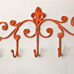 Iron Wall Hook, Bright Orange by Aqua Xpressions - I love the rustic look paired with the bright orange. It would go so well with bright accents or neutrals.