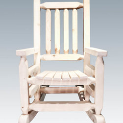 """Montana Woodworks - Homestead Rustic Rocker, Child's, Lacquered - From Montana Woodworks, the largest manufacturer of handcrafted, heirloom quality rustic furnishings in America comes the Homestead Collection line of furniture products. Handcrafted in the mountains of Montana using solid, American grown wood, the artisans rough saw all the timbers and accessory trim pieces for a look uniquely reminiscent of the timber-framed homes once found on the American frontier. This smaller, child's-sized version of Montana Woodworks extremely popular rocking chair is just the right size for your children, grandchildren or younger friends and family. Constructed with the same careful attention to detail as our full-sized rocking chair, our artisans employ the superior, mortise and tenon joinery to ensure this little rocker will be in the family for generations to come. Seat height is 12"""" from the floor and distance between the arm rests is 14"""". Comes fully assembled. 20-year limited warranty included at no additional charge. Hand Crafted in Montana U.S.A.; Solid, U.S. grown wood; Timbers and Trim Pieces are Sawn Square for Rustic Timber Frame Design Appearance; Heirloom Quality; 20 Year Limited Warranty; Durable Build, Fit and Finish; Each Piece Signed By The Artisan Who Makes It; Solid genuine lodge pole pine; Perfectly Fitted for the Smaller Family Members and Friends. Dimensions: 20""""W x 26""""D x 31""""H"""