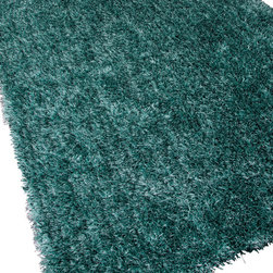 Jaipur Rugs - Shag Solid Pattern Polyester Blue/ Area Rug (2 x 3) - Personal expression reaches new heights with flux, a beautiful range of plush, hand-woven shag rugs of 100% polyester. This chameleon is ideal for the contemporary design lover who enjoys mixing up his or her personal space often acting as a rich background to a diverse palette of furnishings and accessories. Highly textured shag construction brings comfort underfoot while a palette of fashion forward solid hues commands attention in any room.