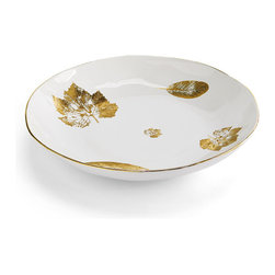Frontgate - Gold Leaf Shallow Serving Platter - Handmade in Italy by locally trained artisans Irregular, organically inspired edge. Contains 10% pure gold, in trim and leaf design. Hand wash recommended. 100% food safe. Do not use in the microwave. Created for Frontgate by one of the oldest factories in Tuscany, the Lamina D'oro Collection celebrates artistic excellence for the table. Starting with high-fired Italian earthenware, local Italian artisans garnish each piece with a gold leaf design and gold trim.  .  .  .  .  .