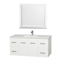 Wyndham Collection - Single Undermount Sink Bathroom Vanity Set - Includes square porcelain sink and matching mirror with shelf. Faucet not included. Two functional doors. Four functional drawers. Plenty of storage and counter space. Single faucet hole mount. White man made stone top. Engineered to prevent warping and last a lifetime. 12 stage wood preparation, sanding, painting and finishing process. Highly water resistant low V.O.C. sealed finish. Unique and striking contemporary design. Modern wall mount design. Deep doweled drawers. Fully extending under mount soft close drawer slides. Concealed soft close door hinges. Made from solid oak hardwood. White and brushed chrome exterior hardware finish. Vanity: 48 in. W x 21.5 in. D x 22.75 in. H. Mirror: 36 in. W x 33 in. H. Care Instruction. Assembly instructions - Vanity. Assembly instructions - Counter Top. Assembly instructions - Undermount Sink. Assembly instructions - MirrorSimplicity and elegance combine in the perfect lines of the Centra vanity by the (No Suggestions) Collection. If cutting edge contemporary design is your style then the Centra vanity is for you modern, chic and built to last a lifetime. You'll never hear a noisy door again! The attention to detail on this beautiful vanity is second to none.