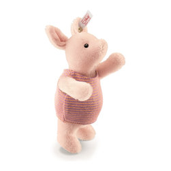 Steiff - Disney Steiff Piglet - Piglet may be small, but his heart is huge. Although he sometimes appears afraid, Piglet is often courageous when coming to the aid of others. Piglet is Pooh's best friend -- loyal and trustworthy. Steiff's version of Piglet is sewn from genuine mohair with hand stitched details.  1-way jointed.