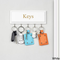 None - Hanging Key Holder - Keep your keys and on-the-go items neatly organized with this darling hanging key holder. Crafted of MDH wood in a smooth finish with five (5) display hooks and 'Keys' engraved in the center, this wall mountable display is ideal for posting by entryways.