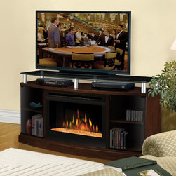 "Dimplex - Dimplex Windham Mocha Electric Fireplace Media Console Multicolor - DFP25-MA1015 - Shop for Fire Places Wood Stoves and Hardware from Hayneedle.com! The sleek low profile of the Dimplex Windham Mocha Electric Fireplace Media Console makes it an ideal combined storage space and ambiance-enhancing addition to any room. Elevated above a bowed cabinet the sturdy glass top showcases your flat panel TV. Ample storage spaces for consoles and DVDs are hidden behind smoked glass cabinet doors so clutter stays out of sight and out of mind. Turn on the fire with the click of a button on your remote snuggle into your easy chair and enjoy both shows. Choose from inner glow logs molded from wood logs for incredible realism or a contemporary glass ember bed that creates an alluring fire on ice effect. The fire adds a special touch of warmth to any room whether the heat is on or off. Operating on only pennies per hour this electric fireplace is so inexpensive to operate you can let the fire - and the action movies - roar all night.About DimplexDimplex North America Limited is the world leader in electric heating offering a wide range of residential commercial and industrial products. The company's commitment to innovation has fostered outstanding product development and design excellence. Recent innovations include the patented electric flame technology - the company made history in the fireplace industry when it developed and produced the first electric fireplace with a truly realistic ""wood burning"" flame effect in 1995. The company since has been granted 87 patents covering various areas of electric flame technology and 37 more are pending. Dimplex is a green choice because its products do not produce carbon monoxide or other emissions."
