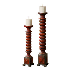 Uttermost Clancy Aged Red Candleholders S/2 - Heavily distressed carved wood with a rust red finish. Distressed white candles included. Heavily distressed carved wood with a rust red finish. Distressed white candles included. Sizes: sm-4x19x4, lg-5x25x5