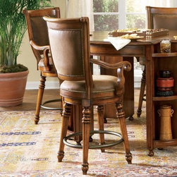 Waverly Upholstered Seat & Back Memory Swivel Bar Stool - If you've always dreamed of having a European pub at home, the Waverly Upholstered Seat & Back Memory Swivel Bar Stool is the perfect touch. As durable as it is beautiful, the cherry-finished frame exudes Old World charm. The faux leather upholstered seat and back may make you linger for hours, while the nailhead trim gives it just the right look. Serve up the fish and chips, and grab a pint and some good friends. Your home just became the destination spot. Please note: This item is not intended for commercial use. Warranty applies to residential use only.Not available for sale in, or delivery to, the state of California.About Hooker Furniture CorporationFor 83 years, Hooker Furniture Corporation has produced high-quality, innovative home furnishings that seamlessly combine function and elegance. Today, Hooker is one of the nation's premier manufacturers and importers of furniture and seeks to enrich the lives of customers with beautiful, trouble-free home furnishings. The Martinsville, Virginia, based company specializes in lifestyle driven furnishings like entertainment centers, home office furniture, accent tables, and chairs.Construction of Hooker FurnitureHooker Furniture chooses solid woods and select wood veneers over wood frames to construct their high-quality pieces. By using wood veneer, pieces can be given a decorative look that can't be achieved with the use of solid wood alone. The veneers add beautiful accents of color and design to the pieces, and are placed over engineered wood product for strength. All Hooker wood veneers are made from renewable resources and are located primarily on the flat surfaces of the furniture, such as the case tops and sides.Each Hooker furniture piece is finished using up to 30 different steps, including 13 steps of hand-sanding and accenting. Physical distressing is done by hand. Pieces receive two to three coats of solid lacquer to create extra depth and add durab
