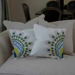 Embroidered Peacock Tail Pillows - These Peacock Tail pillows would be an attractive addition to a white couch, and they add a pop of color at the same time.