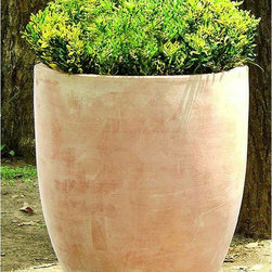 Campania International - Terra Cotta Round Rovigo Round Planter Multicolor - 142588-2401 - Shop for Planters and Pottery from Hayneedle.com! Clean and simple the Terra Cotta Rovigo Round Planter features a rounded design in a traditional warm terra cotta color. Feel free to use the Rovigo to invite guests into your lovingly decorated living room. This premium-quality planter has a drainage hole to protect plant roots from over-saturation. Constructed of high-fire terra cotta and meticulously hand-glazed the Rovigo is frost-resistant for indoor and outdoor use. Dimensions: 24.02 diam. x 27.17H inches. Weighs 106 pounds. Benefits of Terra CottaTerra cotta Italian for baked earth is an unglazed ceramic based from clay. The history of terra cotta includes its use in the famous Terracotta Warriors statues in China. It is widely used today in building materials such as roofing and is a favorite among gardeners to house plants. Terra cotta is useful because of its low cost versatility and durability. Because it is porous terra cotta allows water to vaporize through it which is helpful to plants especially if they have an abundance of moisture. It's gas permeable so helps maintain healthy plants. Its brownish orange color comes from iron oxide in the clay. Compared to items made from other stonework terra cotta items are much lighter in weight. Overall terra cotta makes an excellent choice in the garden.About Campania InternationalEstablished in 1984 Campania International's reputation has been built on quality original products and service. Originally selling terra cotta planters Campania soon began to research and develop the design and manufacture of cast stone garden planters and ornaments. Campania is also an importer and wholesaler of garden products including polyethylene terra cotta glazed pottery cast iron and fiberglass planters as well as classic garden structures fountains and cast resin statuary.Campania Cast Stone: The ProcessThe creation of Campania's cast st