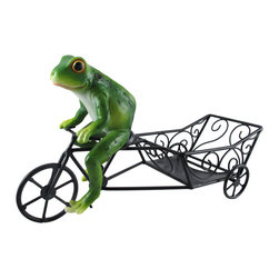`Service With a Ribbit` Frog and Cart Tabletop Single Wine Bottle Holder - This adorable wine bottle holder features a frog on a bike cart with a special delivery. Made of cold cast resin, it measures 12 inches long, 6 1/4 inches tall, 4 1/2 inches wide. Each one is hand-painted, and is part of a limited edition of only 5000 pieces. It makes a great gift for fans of amphibians, and looks lovely on any table or countertop.