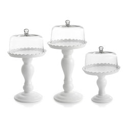 Jay Import Co. - Cake Pedestals with Glass Domes, Set of 3 - Make your pastry pop with these crazy-beautiful cake pedestals. The glass dome shows off the goodies while the lovely white earthenware base raises your treats up to the next level of artistry.