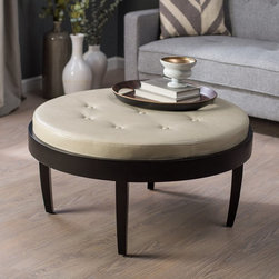 """Armen Living - Citation Coffee Table Ottoman with Removable Cushion - LC6O23OTBCCR - Shop for Ottoman & Footstools from Hayneedle.com! Full speed ahead into the modern era. Unlike speeding tickets the Citation Coffee Table Ottoman will give you the feeling you made a good decision. As it breaks the laws of ordinary decor it delivers a stunning and practical presentation that's totally worth it. A completely removable top cushion makes it a snap to transition from an ottoman to a coffee table. The round table structure is constructed from durable MDF wood covered in a contemporary espresso finish. The comfy tufted cushion comes in either black or cream and fits snugly into the top of the table. Remove the cushion and you have a smooth finished wood surface with a rimmed edge designed to catch any accidental spills that may occur while toasting with guests. Offering the foot-loving comfort of an ottoman and the convenience of a coffee table the Citiation Coffee Table Ottoman is just as ready to receive tired feet as support serving plates teeming with cream cheese wraps and other irresistible hors d' oeuvres. Order this modern piece today and be ready for whatever the future holds. Benefits of Bicast (also bycast) LeatherBicast is a split leather with a layer of polyurethane applied to the surface and embossed. This makes it much more durable tear-resistant and fade-resistant compared to standard leather. It retains a shinier """"new"""" look. The treatment involved in bicast leather eliminates impurities and imperfections in color. It is definitely leather; it's simply treated to make it stronger and easier to maintain and clean. About Armen LivingImagine furniture without limits - youthful robust refined exuding self-expression at every angle. These are the tenets Armen Living's designers abide by when creating their modern furniture collections. Building on more than 30 years of industry experience Armen Living combines functional versatility and expert craftsmanship int"""