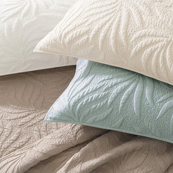 Frontgate - St. Lucia Sham - Trapunto, a quilting technique that originated in Italy before the 14th century, uses extra fill to create an elegant raised pattern on a quilt. Saint Lucia features an allover tropical leaf pattern. Quilted sham has an envelope closure. 100% cotton batting adds softness and loft. Machine wash cold, gentle cycle. Dress your bed with our St. Lucia shams. The hand-sewn trapunto pattern and vermicelli quilting take expert needle workers more than a week to stitch and provide exquisite texture and old-world charm.  . .  .  .  . Imported.