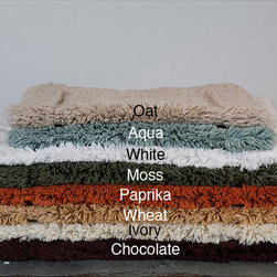 None - Egyptian Cotton Non-slip Soft Contemporary 30 x 50 Bath Rug - A luxurious cotton bath rug will feel great when you step out of the shower. The rug has a soft,cottony feel and features a nonslip coating. The rug measures 30 x 50. Available in paprika,wheat,moss,chocolate,oat,aqua,ivory,and white.