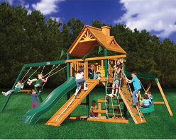 Gorilla Playsets - Gorilla Playsets Blue Ridge Frontier Wood Swing Set - 01-0004 - Shop for Swings Slides and Gyms from Hayneedle.com! Additional featuresMaintenance-free vinyl-coated preserved pine structural beamsChoice grade factory-stained woodSolid 4 x 6-in. main beams5-ft. H deck4 x 4-in. framingTire swing beam with tire swingDeluxe climbing ramp with rope3-position swing beam2 swings with powder-coated chains1 trapeze bar with powder-coated chainsIron ductile swing hangersClimbing rope ladderBuilt-in picnic tableBuilt-in sandboxClimbing rock wall with ropeExclusive Tic-Tac-Toe spinner panelTelescope with imaginative play10-ft. wave slide 10-year warranty on Gorilla Playsets frame1-year warranty on Gorilla Playsets accessories The Gorilla Playsets Blue Ridge Frontier Wood Swing Set combines an abundance of play features with outstanding craftsmanship and resilient materials. This swing set is constructed from factory-stained and sealed preserved pine including vinyl-coated preserved pine structural beams all of which are resistant to rot decay and insect damage. These beams are held together securely with galvanized countersunk bolts to resist weather and provide an added element of safety. A 4x6-foot clubhouse play deck features a tongue-and-groove A-frame wood roof overhead to provide shelter and shade. Below a built-in picnic table provides the ideal place for lunches and snacks.About Gorilla PlaysetsSince 1992 Gorilla Playsets has been designing and selling ready-to-assemble playsets. With a reputation for providing excellent customer service Gorilla Playsets conveniently provides customers with affordable playsets including quality wood components sturdy playset accessories all necessary hardware and clear instructions. Gorilla Playsets always keeps safety in mind while creating inventive durable products that provide children with myriad possibilities for fun and play.
