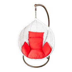 Hanging White Rattan Chair with Red Cushions - A white hand-woven weatherproof synthetic plastic rattan hanging chair with red cushions, so leisurely that it takes you back to the tropics! The rattan teardrop shaped form creates the space for a cozy nest of cushions and hangs from a strong rust resistant iron frame. It is a striking example of high design for your indoor or outdoor living space. Rattan is tailored for those who appreciate upscale furniture design with a tropical edge.
