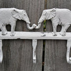 Elephant Coat Rack/Wall Hook/Cast Iron by The Shabby Shak - This elephant wall hook may be double the luck, but it does triple the work with three hooks. The material is cast iron, but I love the weathered white paint. It feels like a great flea market find but without all the time spent searching for it.